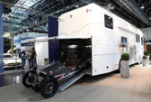 DUSSELDORF - SEPTEMBER 4: ACE Cycle Car in a garage of a large RV at the Caravan Salon Exhibition 2013 on September 04, 2013 in Dusseldorf, Germany — Foto Stock