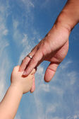 Kid holding father's hand — Stock Photo