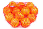 Fresh tangerines in a netted bag — Stock Photo
