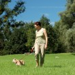 Woman walking her dog — Stock Photo