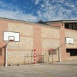 An open basket ball court in a school — Stock Photo