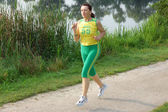 Fit senior woman jogging — Photo