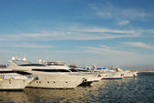 Luxury sports car and yachts in the harbor of Marbella, Spain — Stock Photo