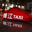 Taxi at night downtown in Shanghai, China — Stock Photo #32339125