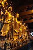 Golden statue in a buddhist temple in Shanghai, China — Stock Photo