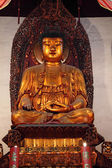 Golden buddha statue in a temple in Shanghai, China — Stock Photo