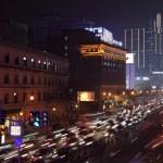 Street downtown in Shanghai illuminated at night — Stock Photo