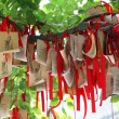 Stock Photo: Paper prayers and wishes at Temple of Confucius in Shanghai, China