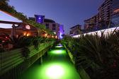 Green illuminated canal in Ocean Village Marina, Gibraltar — Stock Photo