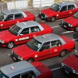 Stock Photo: Classic red taxis in street of Hong Kong