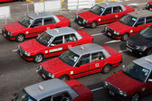 Classic red taxis in the street of Hong Kong — Stock Photo