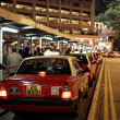 Taxi rank in Hong Kong at night — Stock Photo