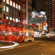 Double decker tramway in Hong Kong city at night — Stock Photo