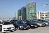 Luxury cars in parking lot in Hong Kong — Stock Photo