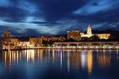 City of Malaga illuminated at dusk. Andalusia, Spain — Stock Photo