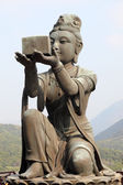 Buddhistic statue making offerings to the Tian Tan Buddha in Hong Kong — Stock Photo