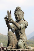 Buddhistic statue making offerings to the Tian Tan Buddha in Hong Kong — Zdjęcie stockowe