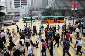 Crowded street crossing downtown in Central Hong Kong, China — Stock Photo