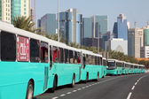 Buses on the Corniche of Doha at Qatar National Day, 18th December 2013 — Foto de Stock