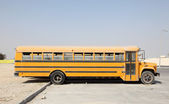 Yellow school buses in a parking lot. Doha, Qatar, Middle East — Stockfoto