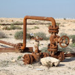 Rusty oil pipes in the desert of Bahrain. Middle East — Stock Photo #44310733