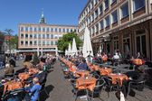 Relaxing in a street cafe on a sunny day. City of Munster in North Rhine-Westphalia, Germany — Stock Photo