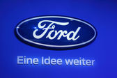 LEIPZIG, GERMANY - JUNE 1: Ford Logo and motto - Eine Idee weiter (an idea forward) at the AMI - Auto Mobile International Trade Fair on June 1st, 2014 in Leipzig, Germany — Stock Photo