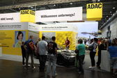 LEIPZIG, GERMANY - JUNE 1: ADAC stand at the AMI - Auto Mobile International Trade Fair on June 1st, 2014 in Leipzig, Germany. ADAC is the biggest german automobile club — Foto Stock