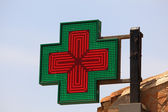 Illuminated pharmacy sign — Stock Photo