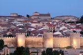 Medieval city walls of Avila illuminated at dusk. Castile and Leon, Spain — Stock Photo