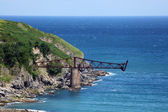 Old iron bridge at the atlantic ocean coast in Cantabria, Spain — Stock Photo