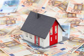 Model house on euro banknotes — Stock Photo