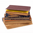 Old books on a pile on a white background — Stock Photo