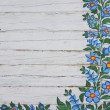 Old plank with floral folk motive — Stock Photo #43420353