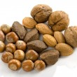 Heart, nuts, dried fruits and nuts - Stock Photo