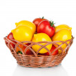 Ripe red and yellow tomatoes in wicker basket isolated on white — Stock Photo #18519271