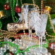 New Year's collage with glasses of champagne. Decorations and ribbons on a bright color background  — Stock Photo