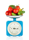 Healthy eating. Kitchen scale with vegetables isolated on white — Stock Photo