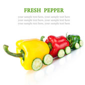 Train made of various sweet pepper vegetables and cucumbers isol — Stock Photo