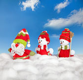 Happy winter snowman friends and santa claus — Stock Photo
