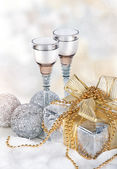 Champagne, gift box, snow, christmas toys and fir-tree — Stock Photo