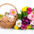 Easter egg decoration in basket and tulip flowers isolated on wh - Stock Photo