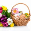 Stock Photo: Easter egg decoration in basket and tulip flowers isolated on wh
