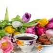 Bouquet of colorful tulips and tea cup full of tea isolated on — Stock Photo
