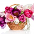 Basket with colorful bouquets of spring tulips flowers  isolated - Stock Photo