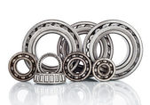 Composition of steel ball roller bearings in closeup isolated on white background — Stock Photo