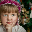Little child girl near Christmas tree. Happy new year — Stok fotoğraf
