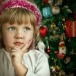 Little child girl near Christmas tree. Happy new year — 图库照片