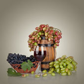 Barrel, bottles, grapes and glass of wine isolated on white back — Stock Photo