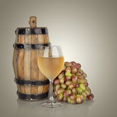 Barrel, bottles and glass of wine and ripe grapes isolated on wh — Stock Photo
